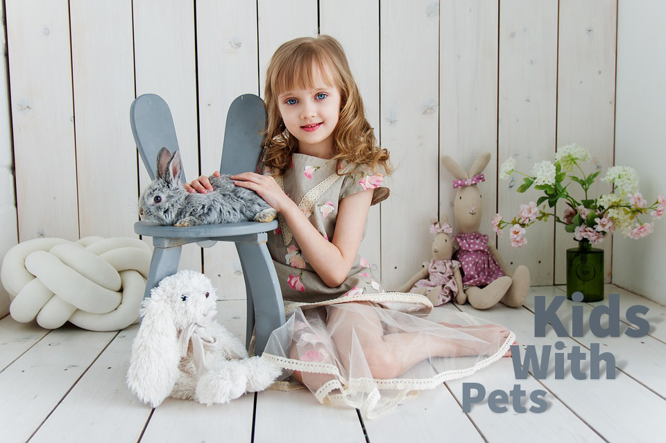 baby with pet and toys